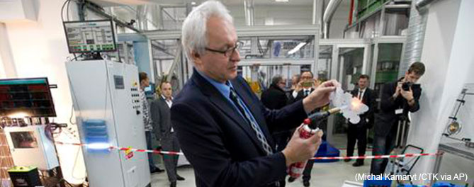 Company HE3DA President Jan Prochazka shows qualities of a new battery during the official start of a battery production line in Prague, on Monday, Dec. 19, 2016. Read more at: https://phys.org/news/2016-12-czechs-production-batteries-based-nanotechnology.html#jCp